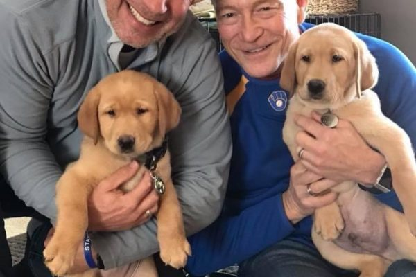 steve and mark with puppies